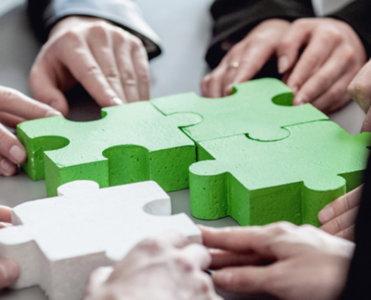 Business People Assembling Puzzle X Copy